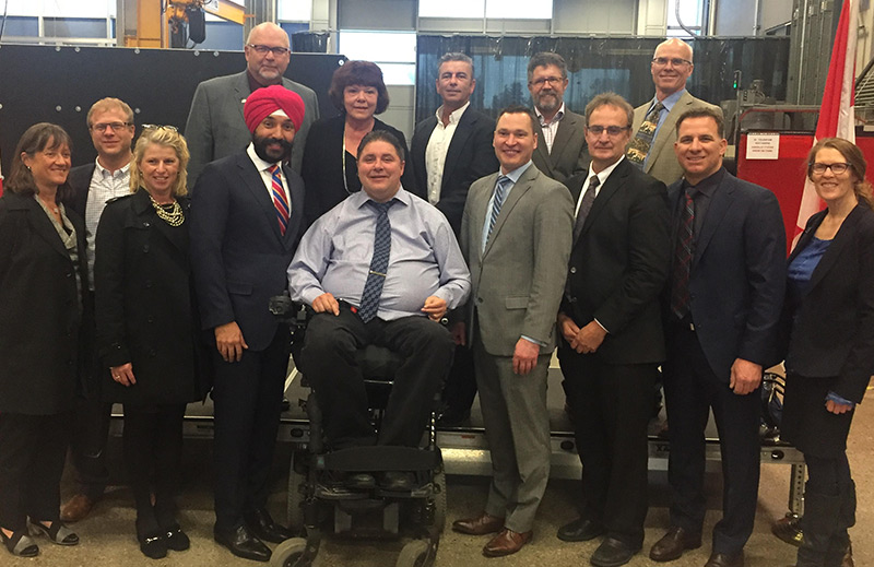 The Honourable Navdeep Bains, Minister of Innovation, Science and Economic Development is joined by members of the Smart Agri-Food Supercluster and government.