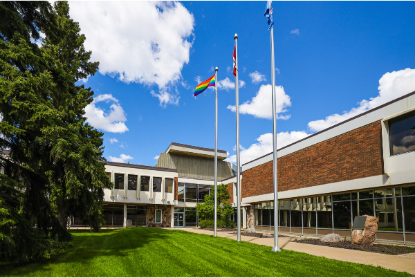 Pride Flag flies in front of Olds College.